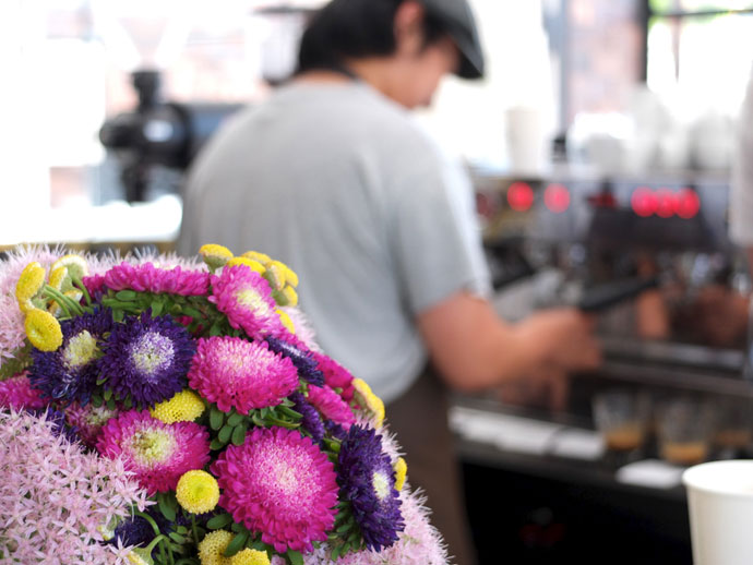 barista and flowers