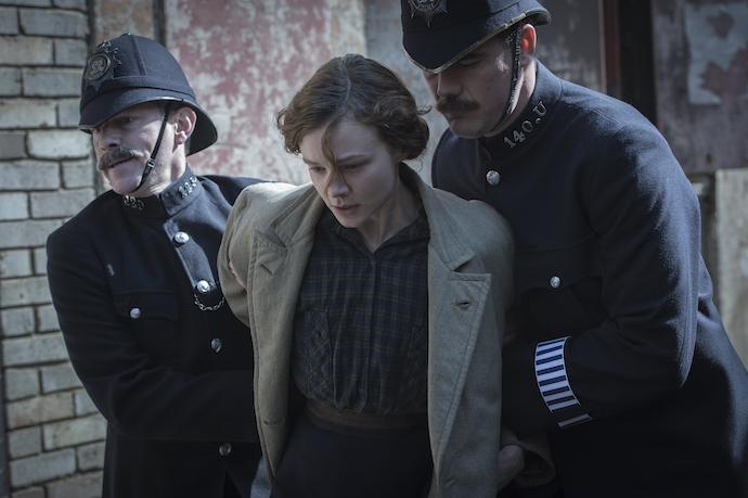 Carey Mulligan as Maud Watts struggle against police