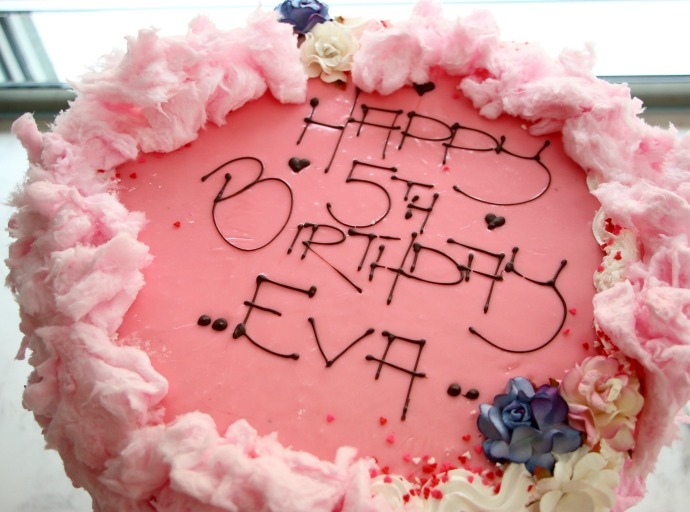 pink birthday cake with fairy floss