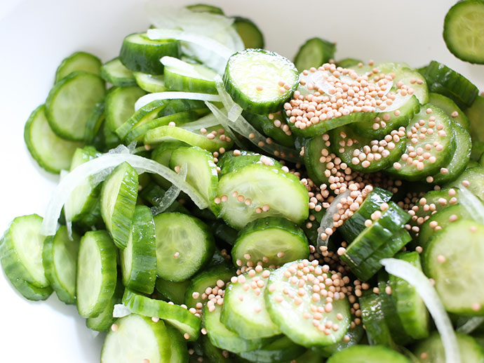 Mix cucumber, onion and mustard seeds.