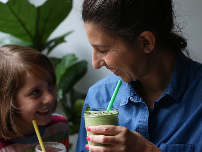 mother and daughter drinking smoothies