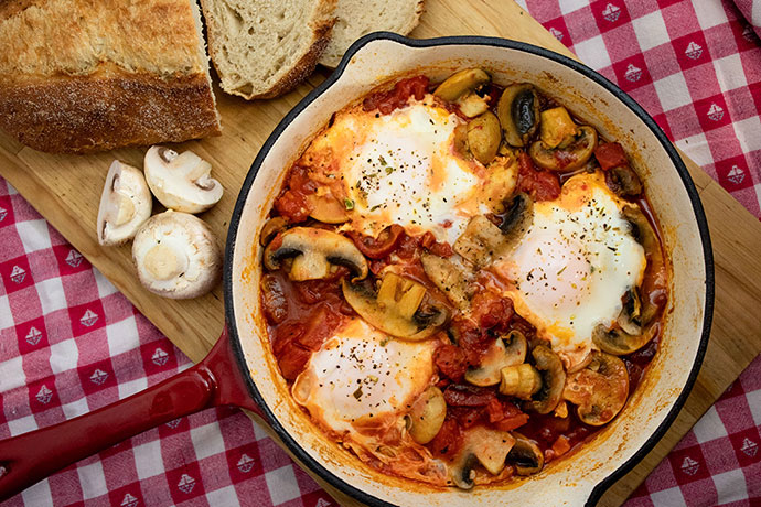 Baked eggs in a red skillet with mushrooms - mypoppet.com.au