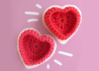 2 crochet heart shaped baskets on violet background