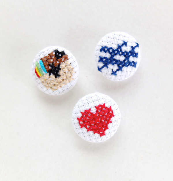 Fabric coverd buttons with cross stitch Instagram logo mypoppet.com.au