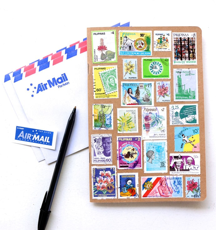 Upcycle old stamps to decorate a notebook