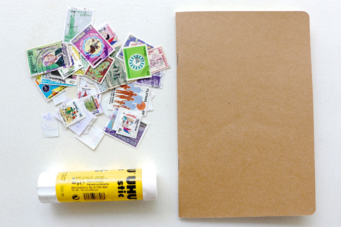 Decorate a notebook with old stamps - supplies