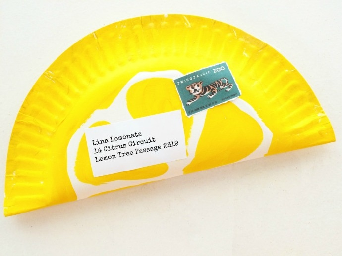 Send a letter in a slice of lemon made from a paper plate