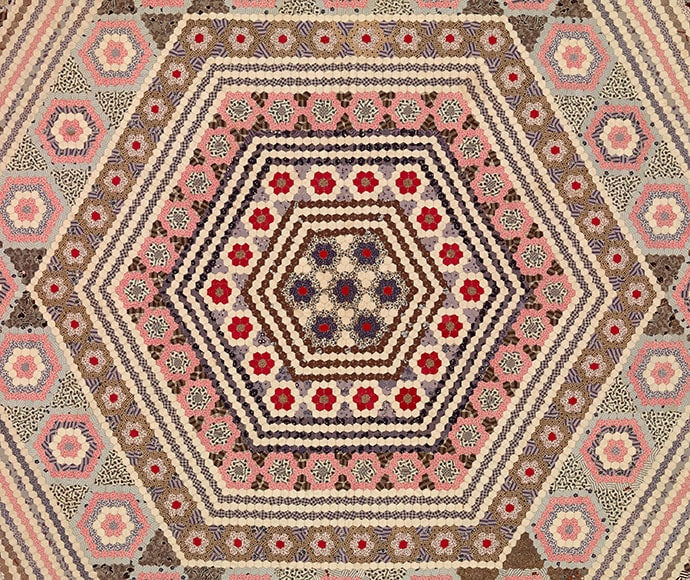 Prudence Jeffrey (nee Pascoe) born England 1831, arrived Australia 1857, died 1900 Miniature hexagons quilt 1857 (detail) cotton 171.5 x 198.5 cm Collection of Janene Ford, Melbourne, image supplied NGV