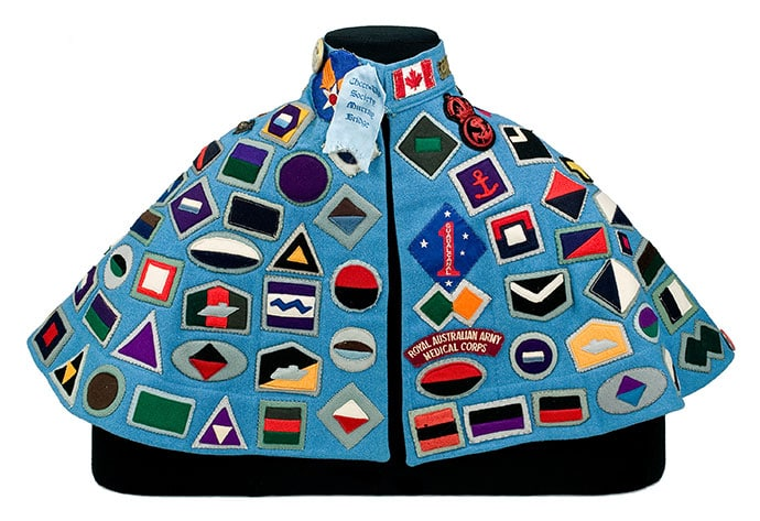 Golda Jean Ellis (later Neall) Australia (1917–22)–2003 Cheer Up Society cape c. 1941–42 (interior) wool (flannel, felt), cotton, silk, metal, enamel, transparent synthetic polymer resin 51.0 x 92.0 cm Australian War Memorial, Canberra Donated, 2004