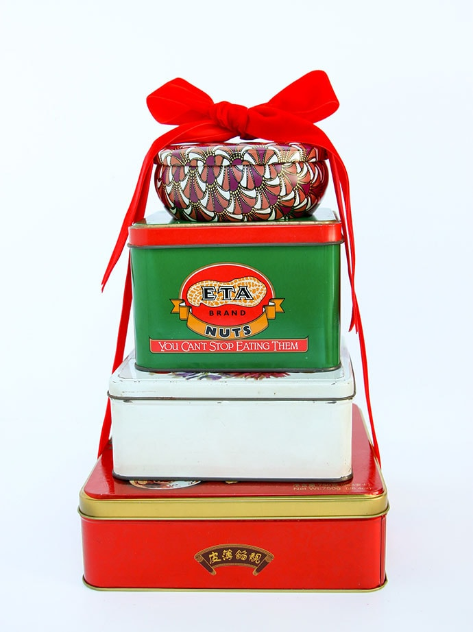 Vintage tins stacked with a bow. Christmas Vintage tin gift ideas