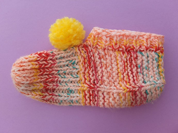 knitted slippers with ribbed ankle band.