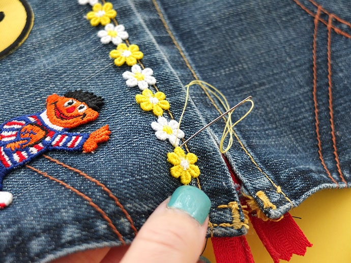 2484468b90a 4/ To ensure trim and patches will stay on after repeated use, tack down  the embellishments with some hand stitches.