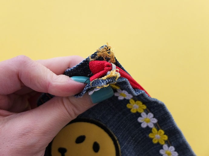 How to sew a zippered poch from old jean pockets