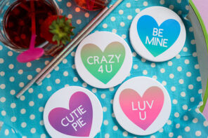 heart coasters on blue drinks tray - infusible ink coasters