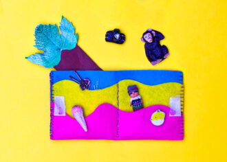 kids wallet with rainbow pockets on yellow background