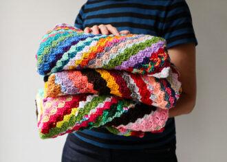 Pile of crochet baby blankets