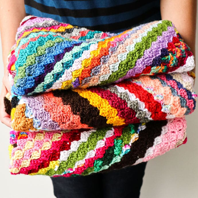 Pile of crochet baby blankets - corner to corner crochet