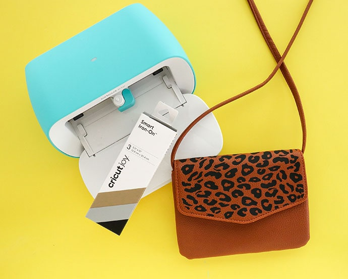 Cricut Joy cutting machine and brown leather bag