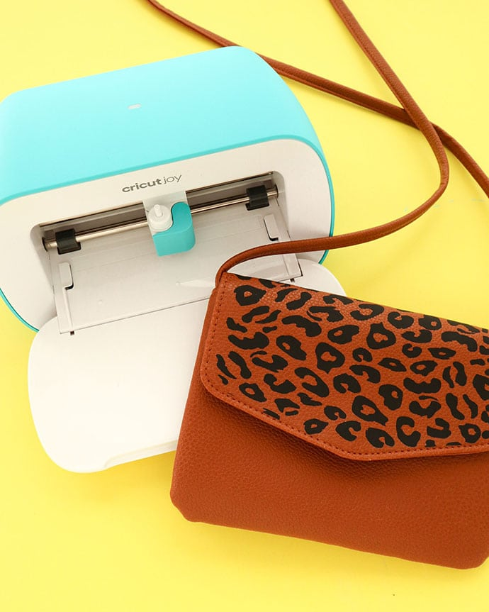 Cricut Joy cutting machine and brown leather bag