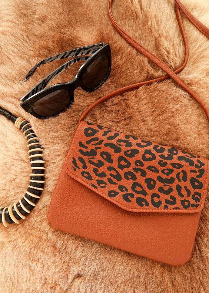 leopard print bag makeover DIY - brown handbag sunglasses on fur background
