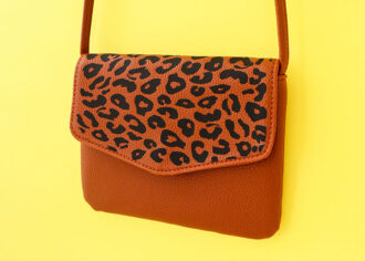 brown leather bag with leopard print flap