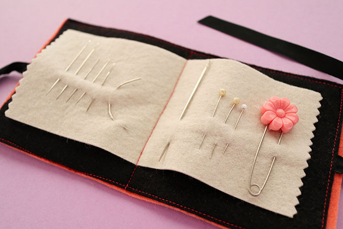 Felt needle book holding pins and needles