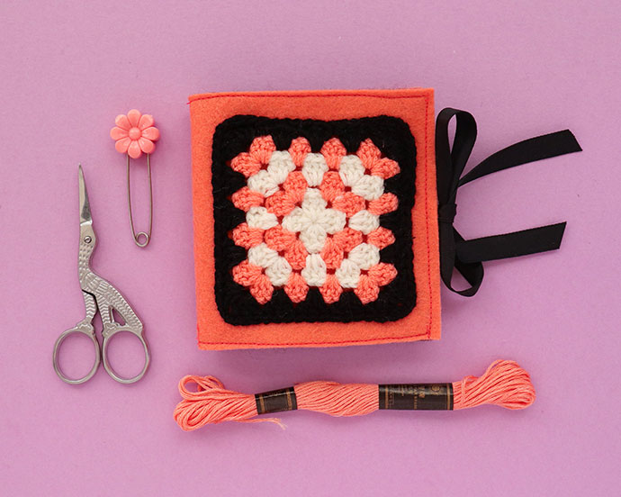 Granny square needle book with embroidery floss and scissors