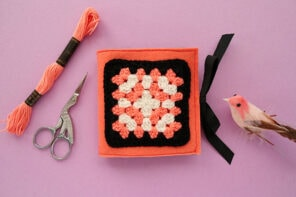 Granny square needlebook with embroidery floss and scissors
