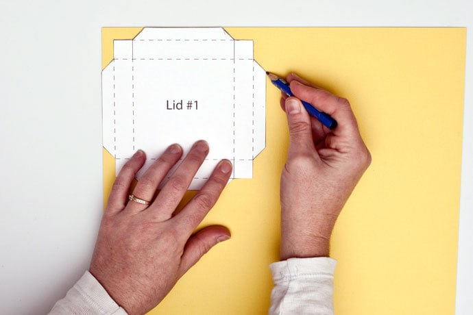 tracing Gift box lid template onto yellow paper