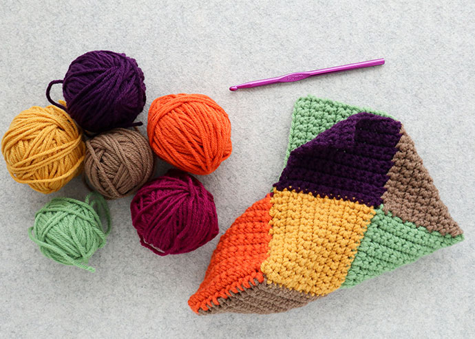 assorted coloured yarn with crochet slipper