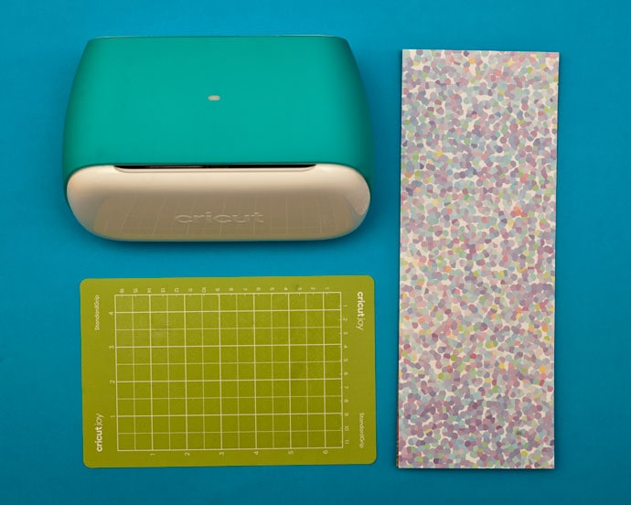 Cricut Joy machine with sticker sheet supplies