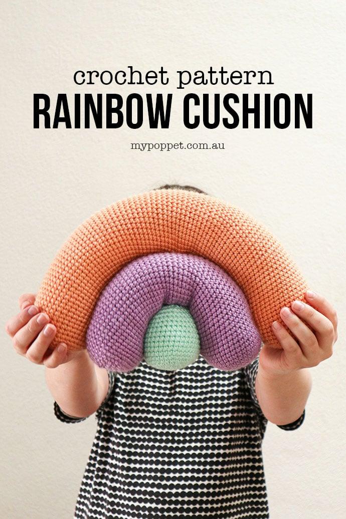 Rainbow Cushion Crochet Pattern - mypoppet.com.au - Girl holding crochet rainbow shape pillow