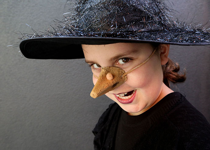 girl wearing Homemade witch nose halloween costume