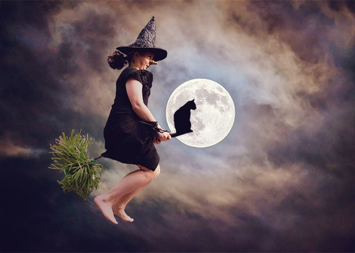 Girl flying on a broom in front of a full moon
