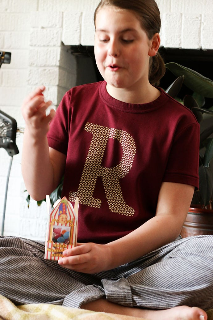 Girl wearing Ron Weasley sweater cosplay and bertie bott's jelly beans