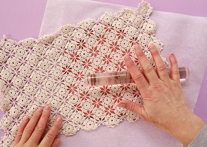 roll lace onto clay to make pattern