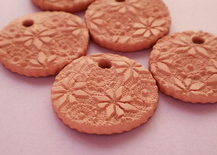embossed lace pattern in air dry clay - how to make a terracotta oil diffuser