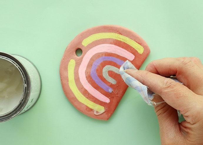 Paint a rainbow on clay ornament