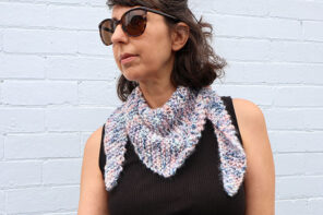 woman wearing knitted shawl