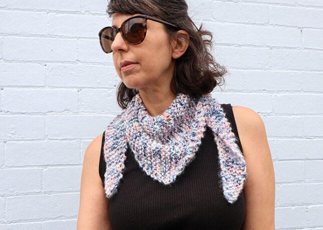 woman wearing knitted shawl