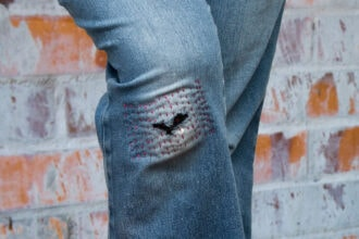 jeans with mended knee hole of sachiko stitching