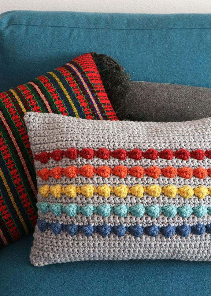 Rectangle crochet cushion with rainbow stripes
