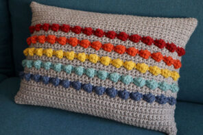 crocheted bobble stripe rainbow pillow