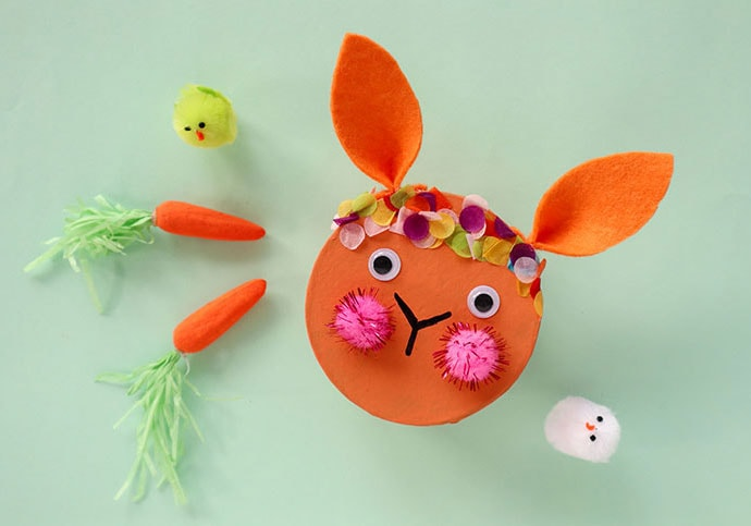 round Easter bunny gift box with 2 carrots and 2 small chicks as decoration