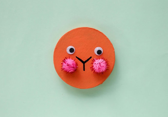 glue on pom pom and eyes to make rabbit face on box