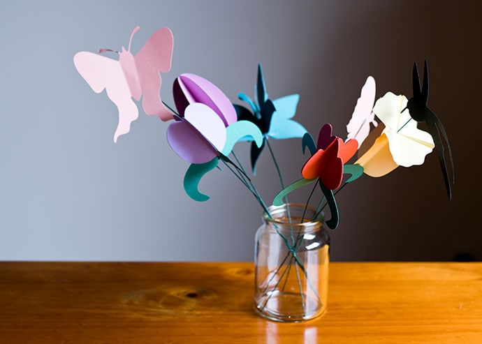 bouquet of paper flowers in glass jar