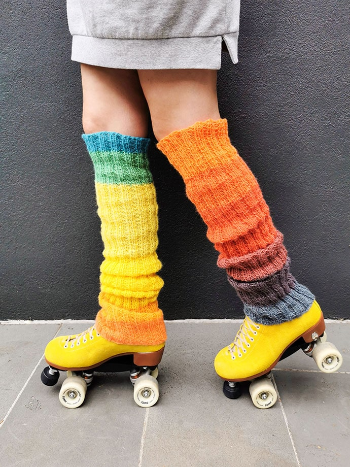 legs with rainbow leg warmers and yellow rollerskates 80s vibe
