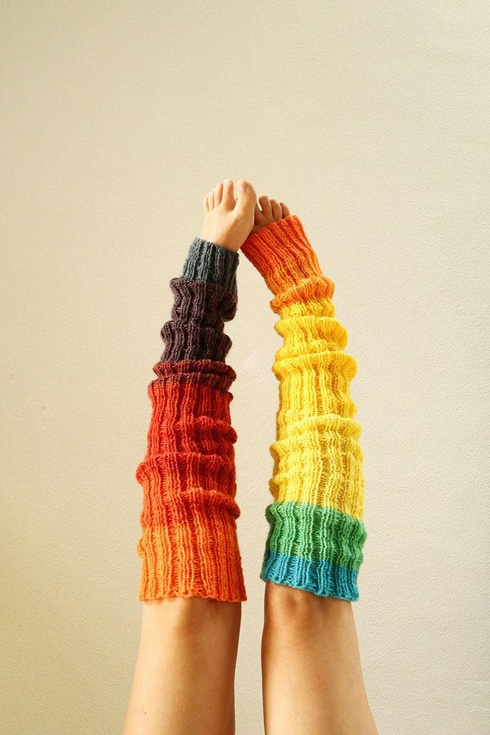 rainbow knitted legwarmers on legs