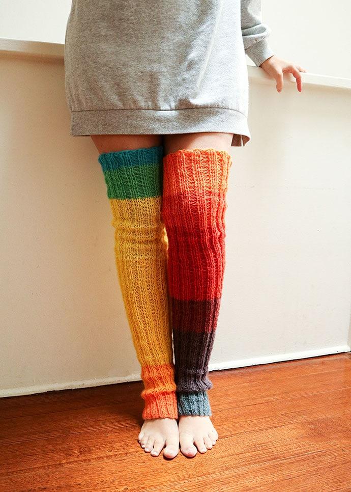 woman wearing long rainbow knitted leg warmers