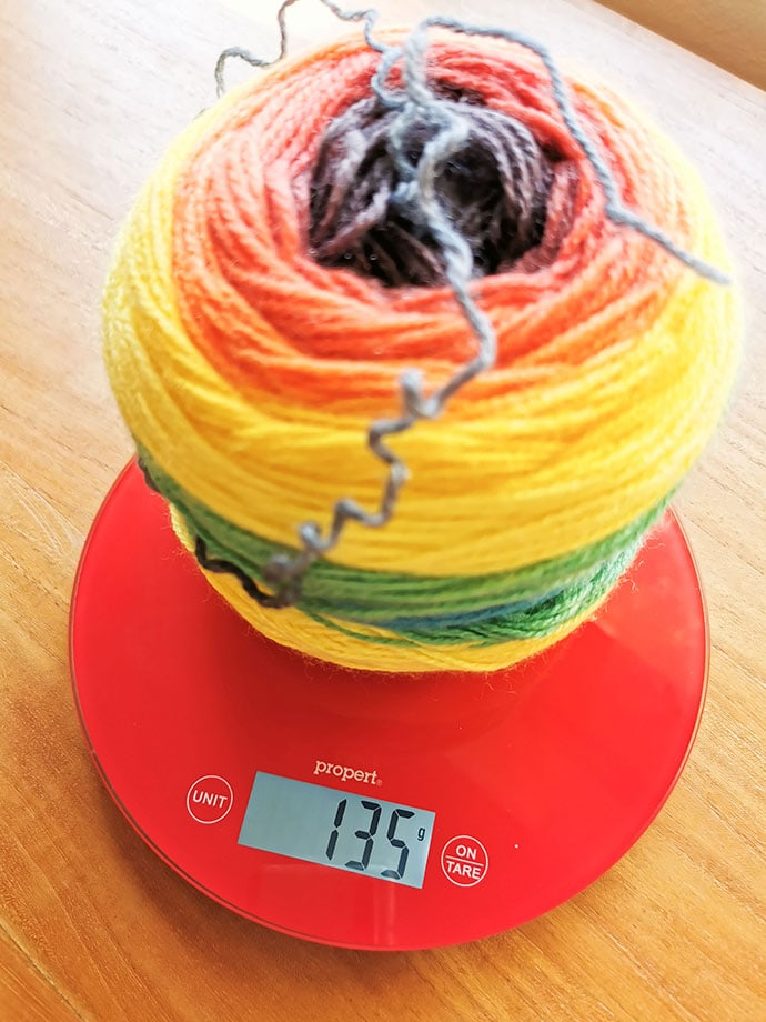 Ball of yarn on scales